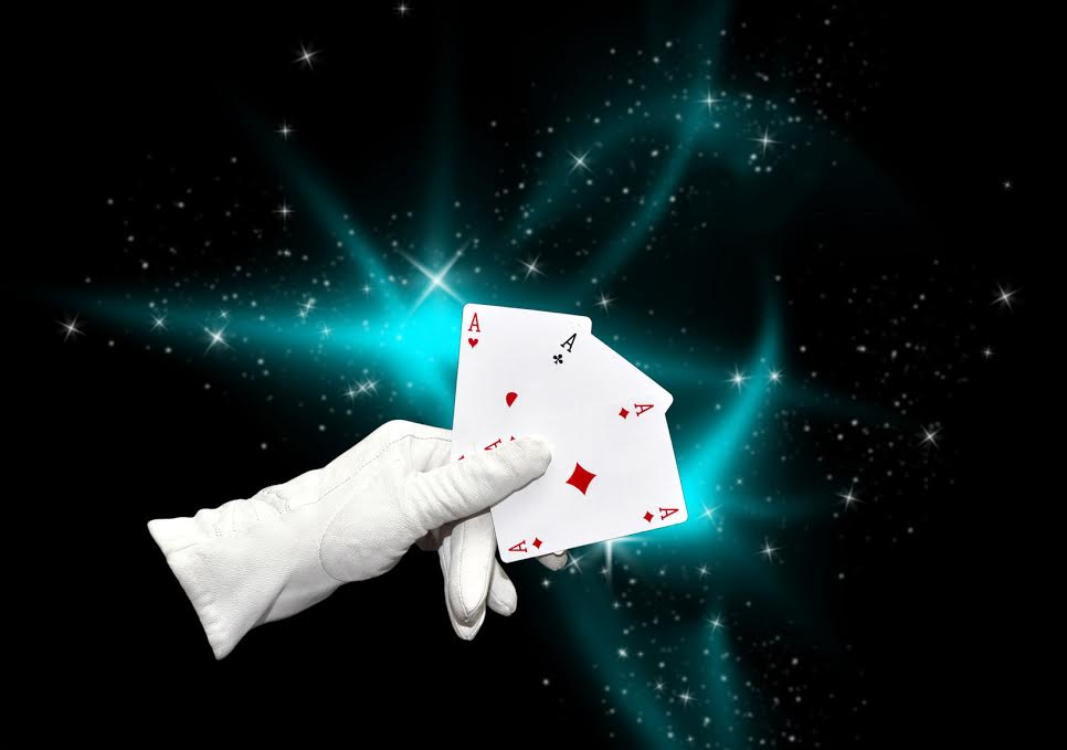 29001539 - hand in white glove holding three aces